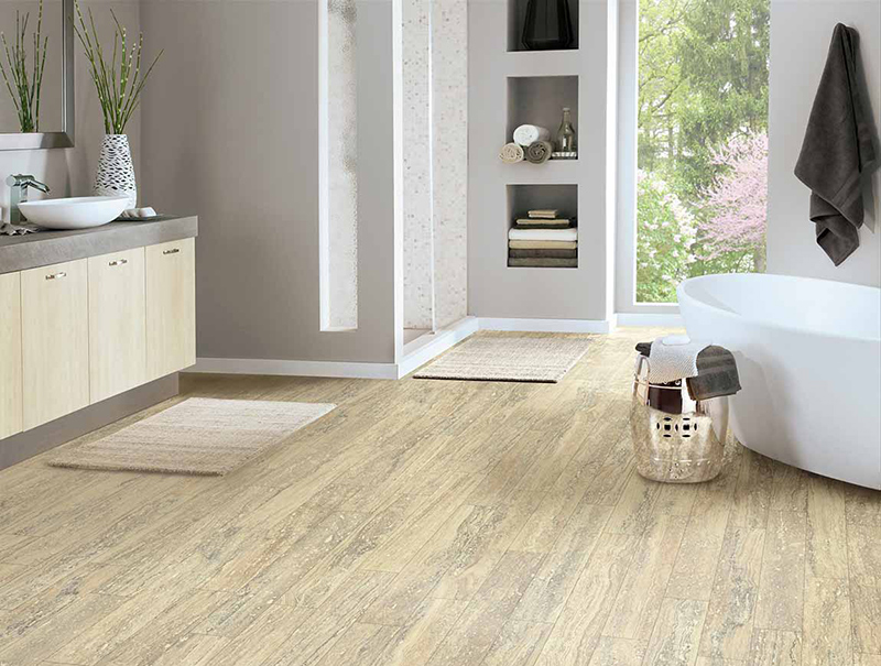 Bright and clean bathroom with a light brown wood-look porcelain tile floors